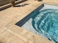 Margelle en travertin - Photo piscine à coque